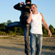 Royalty-Free Stock Photo: Bandit in mask trying to rob young man