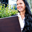 Stok fotoğraf: Attractive businesswoman with notebook in city park
