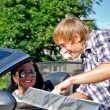 Male tourist asking female driver about direction — Stock Photo