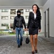 Stock Photo: Bandit in mask following businesswoman. Robbery concept