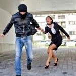 Постер, плакат: Bandit stealing businesswoman bag in the street