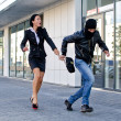 Stockfoto: Bandit stealing businesswoman bag in the street