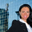 Portrait of pretty woman posing near modern office building — Stock fotografie #12308393