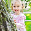 Portrait of a little lovely girl playing in the park — Stock Photo