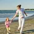 Stock Photo: Mother and daughter having fun near the sea