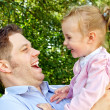 Father and daughter having fun in the park — Stock Photo #12367494