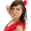 Portrait of attractive woman with red flower in her hair. Isolated on white — Stock Photo
