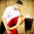 Cute young couple dancing latino — Stockfoto