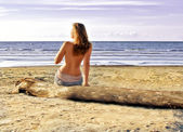 Back view of semi nude woman on the beach — Stock Photo