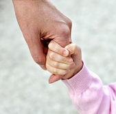Child holding mother's hand — Stock Photo