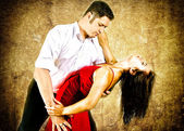 Cute young couple dancing latino — Stock Photo