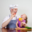 Little girl and her father having fun in the kitchen — Stock Photo #12438810