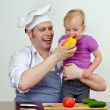 Little girl and her father having fun in the kitchen — Stock Photo #12438838