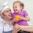 Little girl and her father having fun in the kitchen — Stock Photo #12438841