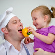 Little girl and her father having fun in the kitchen — Stock Photo #12438852