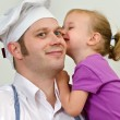 Little girl and her father having fun in the kitchen — Stock Photo