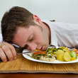 Royalty-Free Stock Photo: Drunk man sleeping in his dinner plate