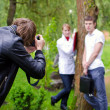 Royalty-Free Stock Photo: Photographer takes picture of young couple outdoors