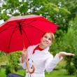 Portrait of pretty woman with umbrella - Stock Photo