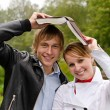 Two students with book in the park — Stock Photo