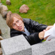 Young man falling down from the bridge — Stockfoto #12704779