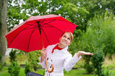 Portrait of pretty woman with umbrella — Stock Photo