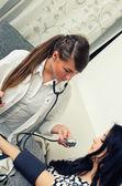 Female doctor measures patient pressure — Stock Photo