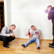 Stock Photo: Murder scene with two forensic analysts investigating crime