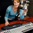 Stock Photo: Portrait of female dj working in front of microphone on radio