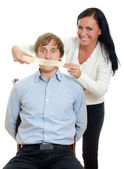 Woman applying tape on man's mouth — Stock Photo