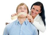 Woman applying tape on man — Stock Photo