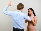 Man slapping a woman depicting domestic violence — Stock Photo