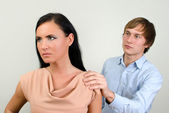 Young couple quarreling. Man asks for forgiveness. — Stock Photo