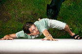 Thief running away from the dog. — Stock Photo