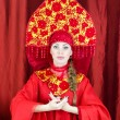 Stock Photo: Womin russitraditional clothes welcomes you