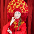 Stock Photo: Womin russitraditional clothes posing