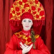 Woman in russian traditional clothes welcomes you. — Stock Photo