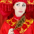 Stock Photo: Womin russitraditional clothes thinking