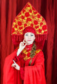 Woman in russian traditional clothes posing — Stock Photo