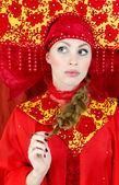 Woman in russian traditional clothes thinking — Stock Photo