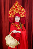 Woman in russian traditional clothes with basket — Stock Photo