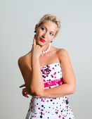Pin-up portrait of woman on grey background — Stock Photo