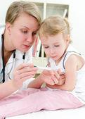 Cute little girl visiting pediatrician — Stock Photo