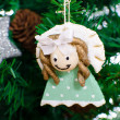 Funny decorative angel on xmas tree — Stock Photo #16858899