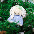 Funny decorative angel on xmas tree — Stock Photo