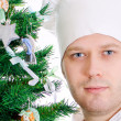 Portrait of chef cook near xmas tree. Isolated on white — Stock Photo