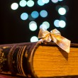 Old book on bokeh lights background — Stock Photo