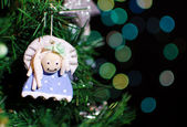 Close up christmas tree with handmade decoration on bokeh lights background — Stock Photo