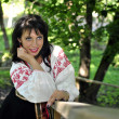 Portrait of pretty woman in russian traditional costume in the park — 图库照片