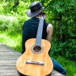 Rear view lonely man with guitar — Stock Photo